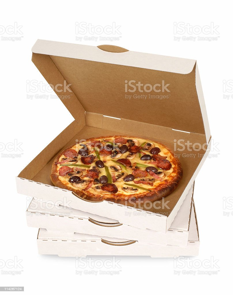 Stack of white boxed pizzas with the top one open stock photo