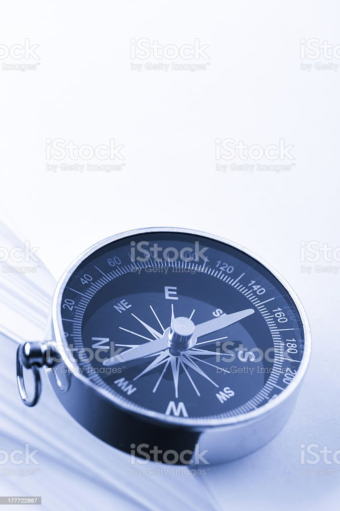 Stack of white cards and compass royalty-free stock photo