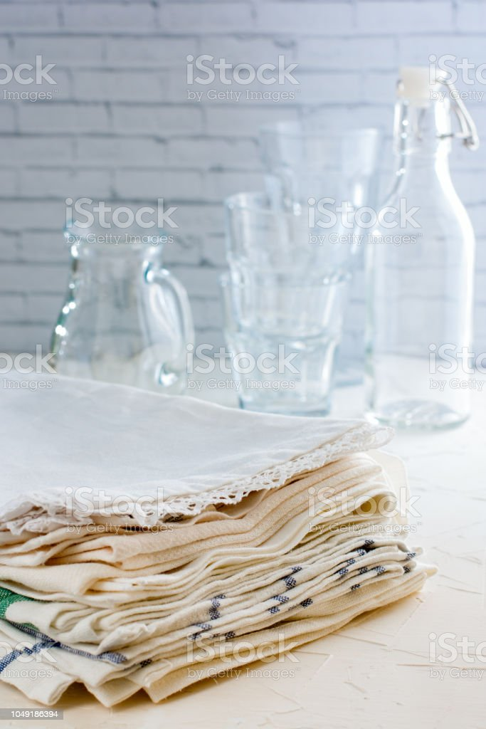 A Stack Of White Cotton Kitchen Towels On The Table ...