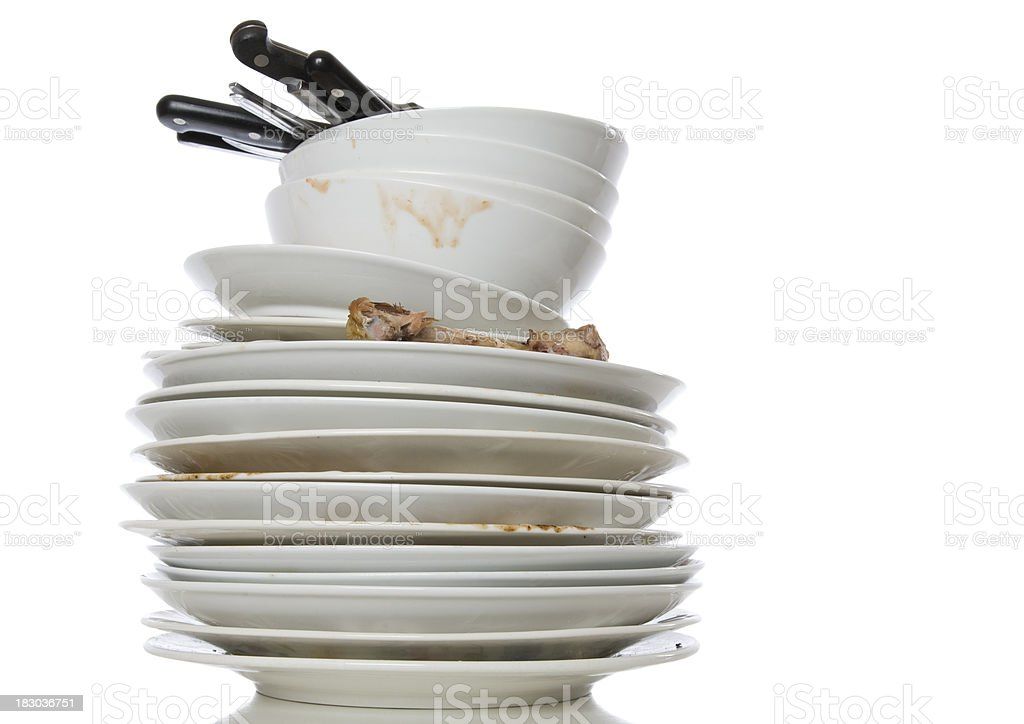 Stack of white dirty dishes on a white background stock photo