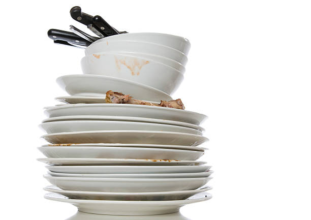 Stack of white dirty dishes on a white background foto