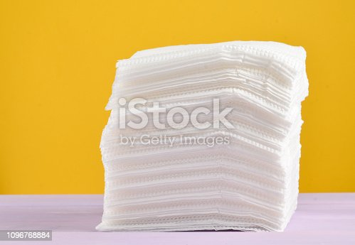 istock stack of white paper napkins on a yellow pastel background 1096768884