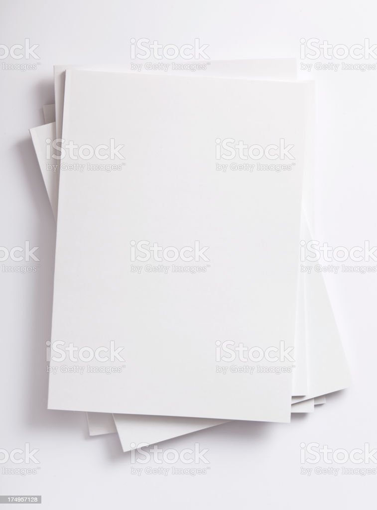 A stack of white papers on a white background stock photo