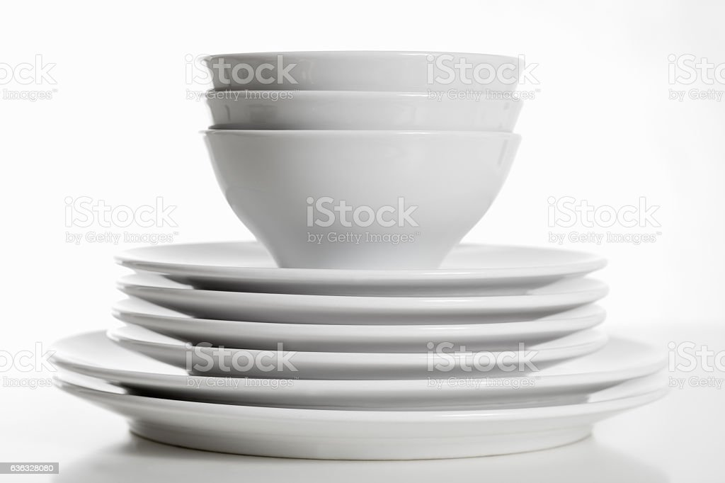 Stack of white plates and bowls stock photo