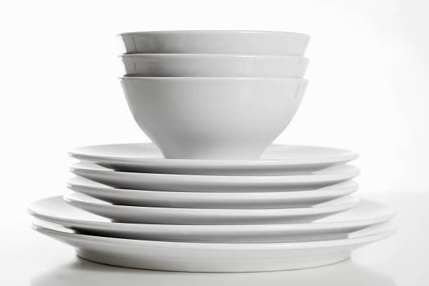 stack of white plates and bowls - skål porslin bildbanksfoton och bilder