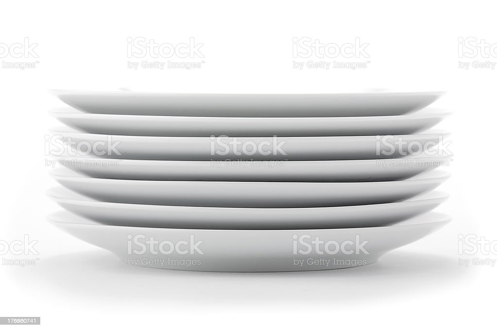 Stack of white plates stock photo
