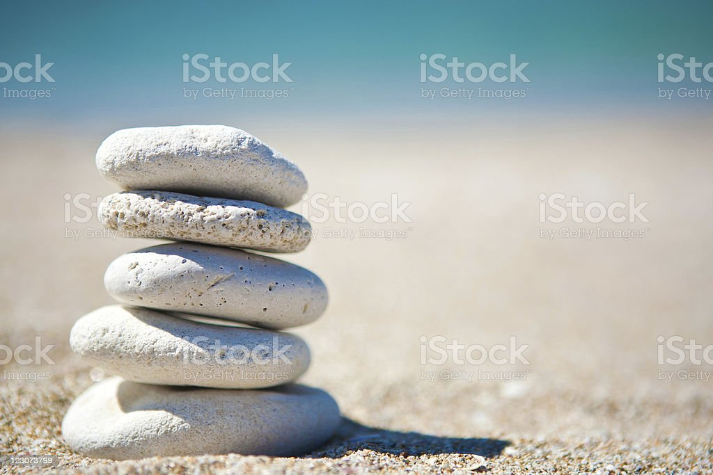 Stack of white stones on tropical beach royalty-free stock photo