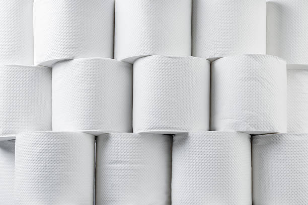 Stack of white tissue paper rolls. Stack of white tissue paper rolls. toilet paper stock pictures, royalty-free photos & images