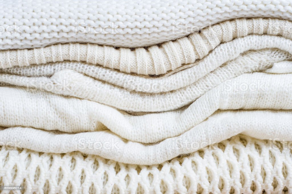 A stack of women's white sweaters stock photo