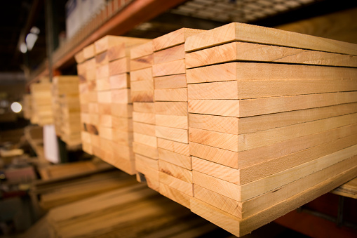 A Stack of Cherry Wood Boards on the Shelf.
