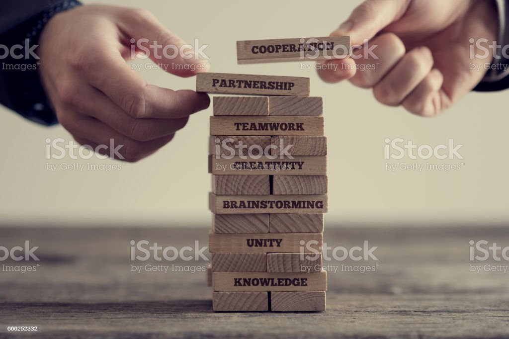 Stack of wooden dominoes with signs stock photo