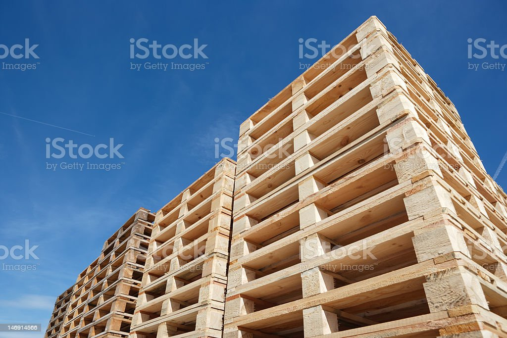 stack of wooden pallets stock photo