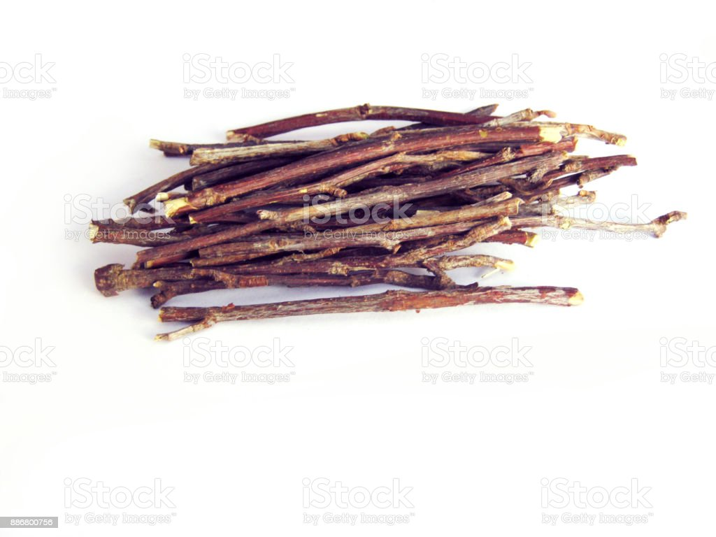 Stack of wooden twigs isolated on white stock photo