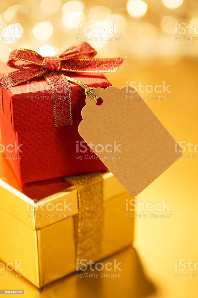 Stack of yellow and red gifts afront blurry background royalty-free stock photo