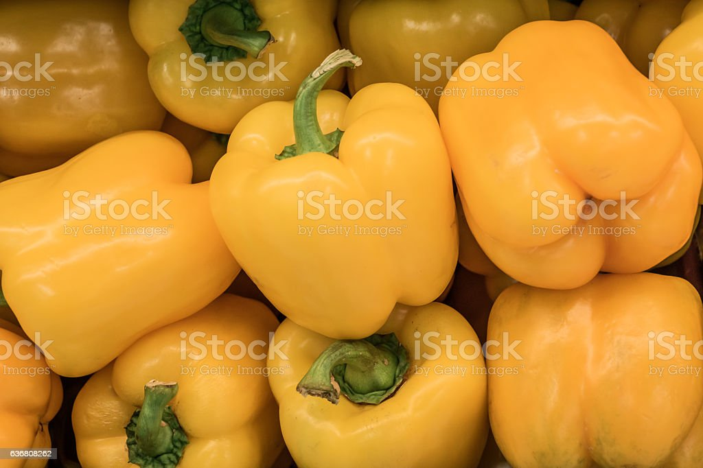 Stack of yellow bell peppers stock photo