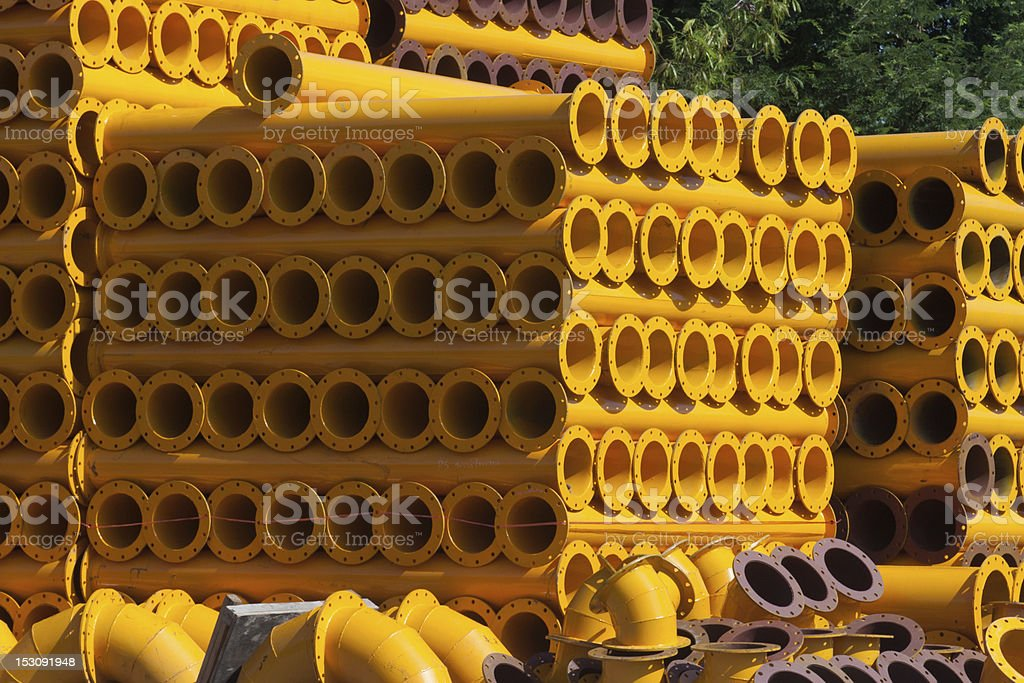 stack of yellow steel pipe royalty-free stock photo