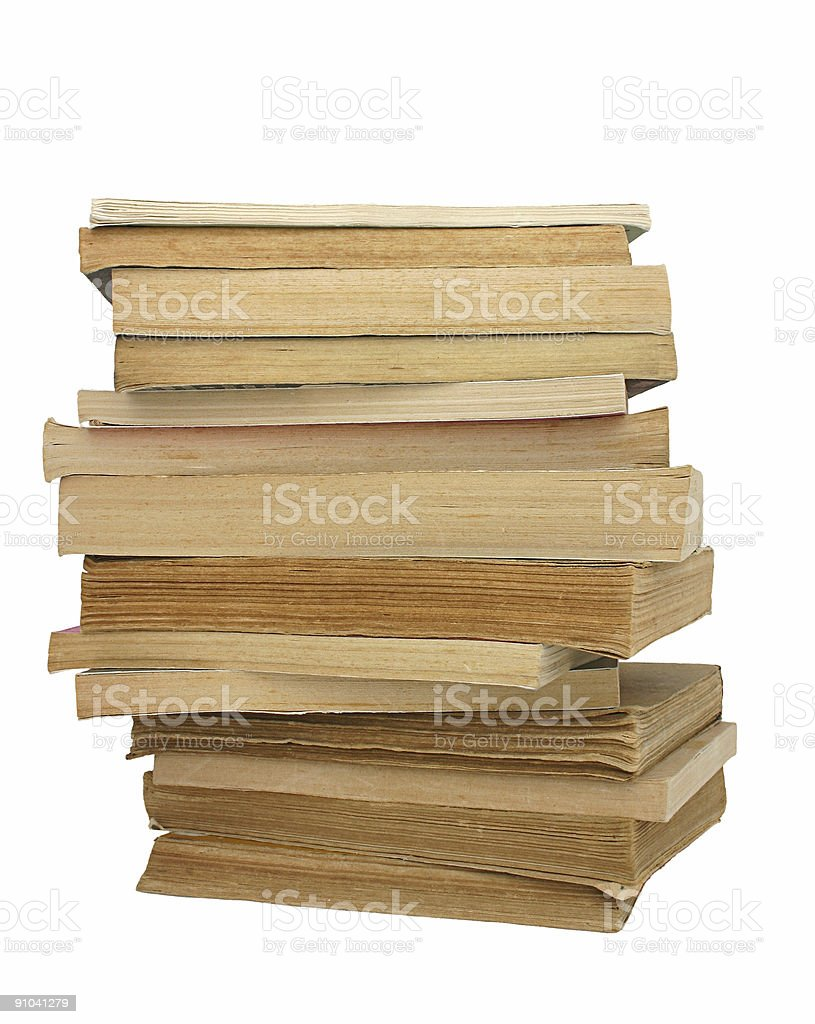 stack of yellowed books stock photo