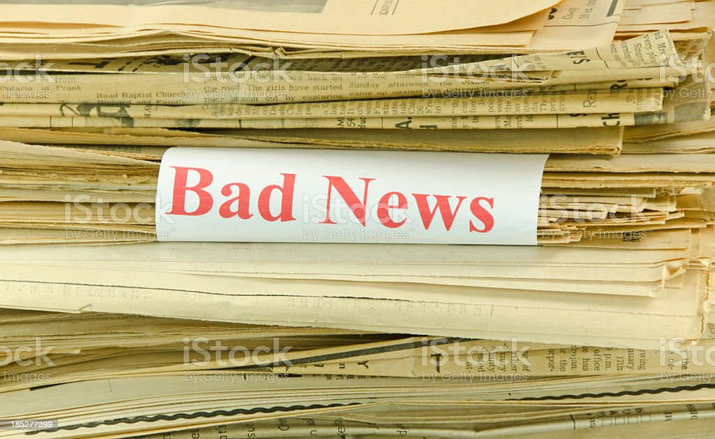 Stack of Yellowed Newspapers and Bad News royalty-free stock photo