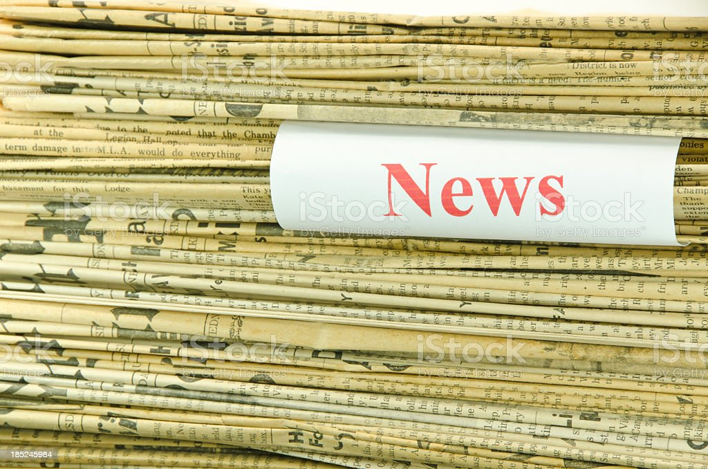 Stack of Yellowed Newspapers and News royalty-free stock photo