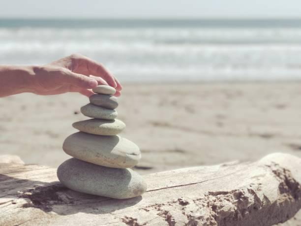 Stack of zen stones on the sea beach. stock photo