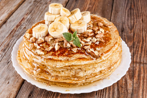 Stack, pancake, pancakes, honey, banana, nuts, Healthy breakfast, Maslennitsa, Russian pancakes. stock photo