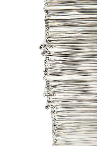 Stack... The edge of a neatly stacked pile of daily news papers...For more newspaper images please click on the banner below... newspaper cutouts of bad news headlines stock pictures, royalty-free photos & images