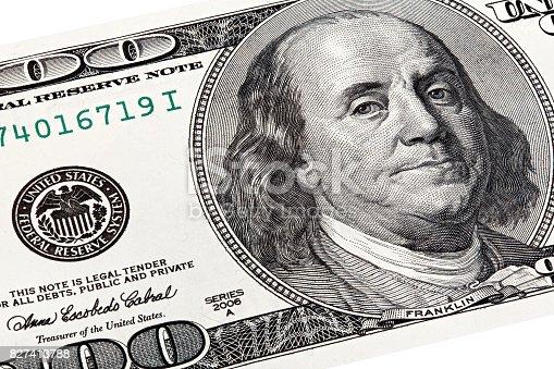 istock Stack shot of Benjamin Franklin portrait from a 100 bill 827413788