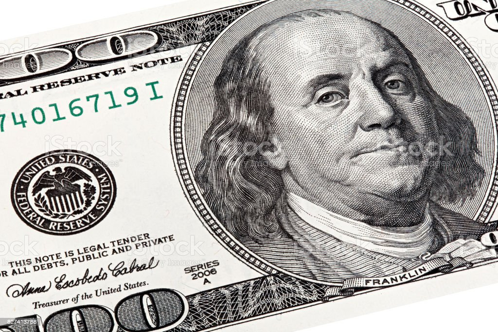 Stack shot of Benjamin Franklin portrait from a 100 bill stock photo