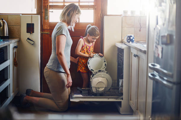 stack them in together carefully now - household chores stock photos and pictures