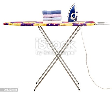 932671892 istock photo Stack towels clean ironing board iron 1068328186