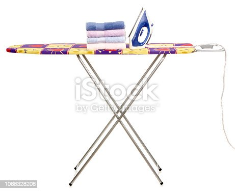 932671892 istock photo Stack towels clean ironing board iron 1068328208