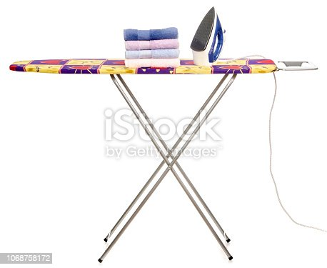 932671892 istock photo Stack towels clean ironing board iron 1068758172