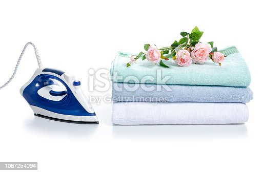 932671892 istock photo Stack towels with iron flowers 1087254094