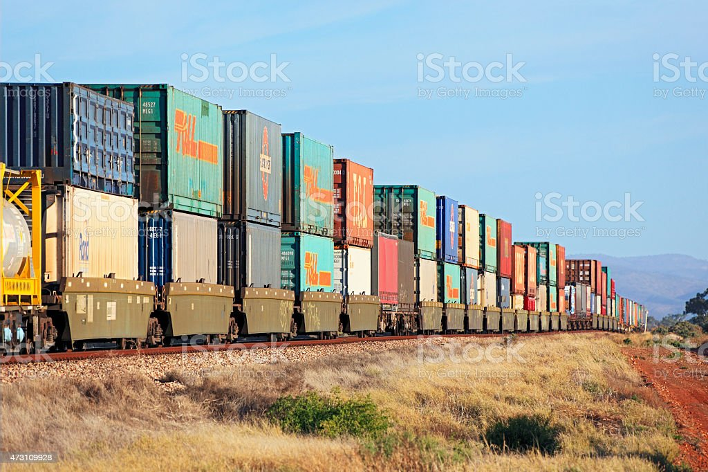 Stack train with multi-coloured containers on outback tracks stock photo