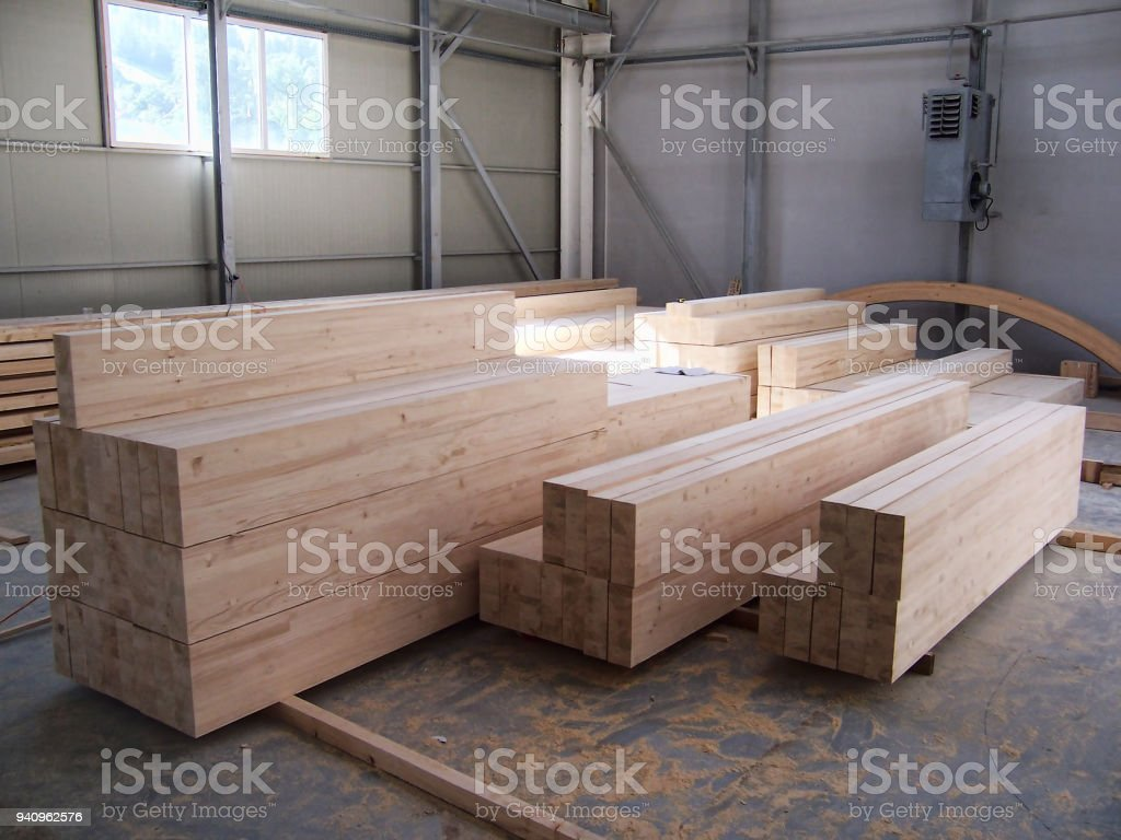 Stack wood beams in the factory stock photo