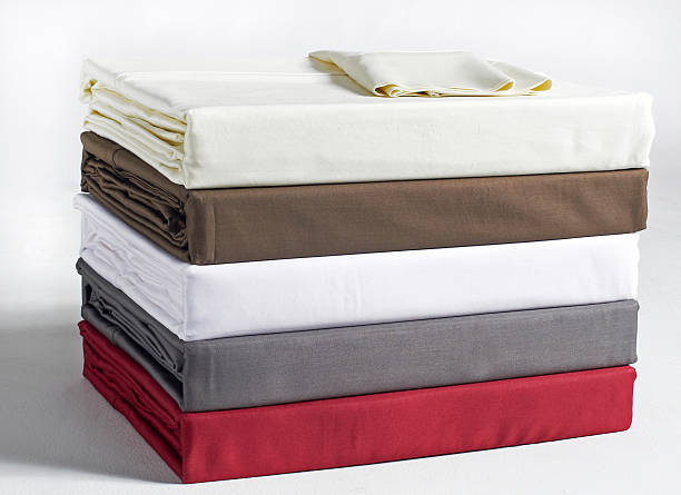 stacked bed sheets stock photo