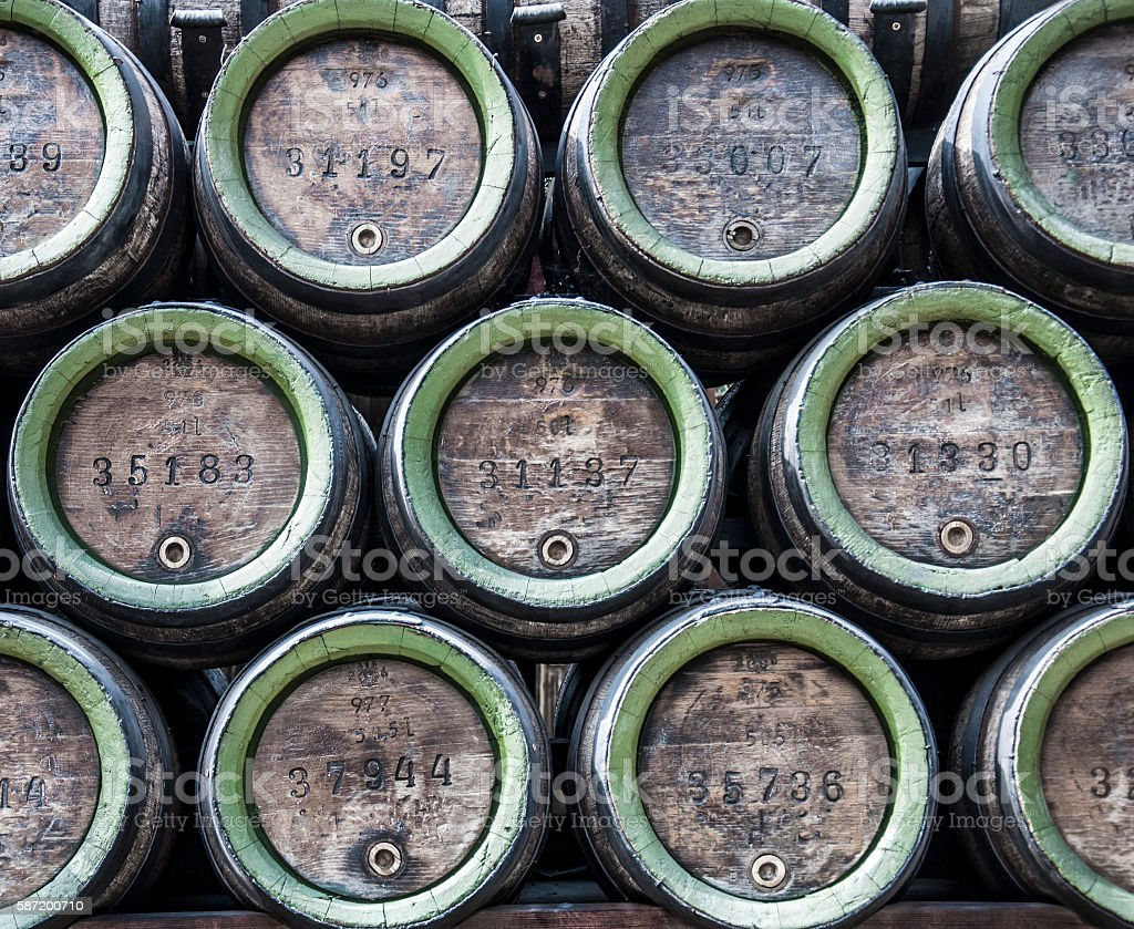 stacked beer barrels stock photo