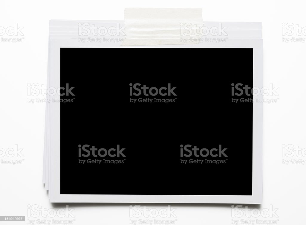 Stacked blank Polaroid with adhesive tape on white background royalty-free stock photo