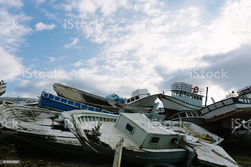 Stacked boat parts in junkyard stock photo