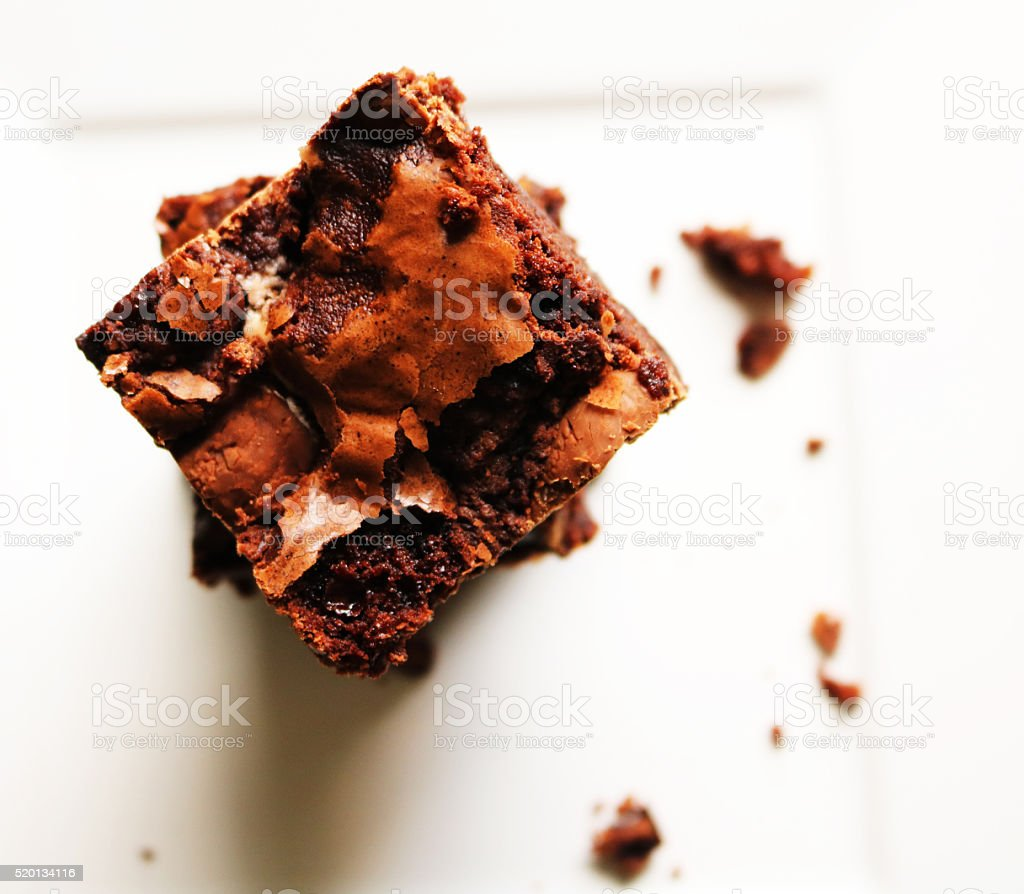 Stacked Brownies on a White Plate stock photo