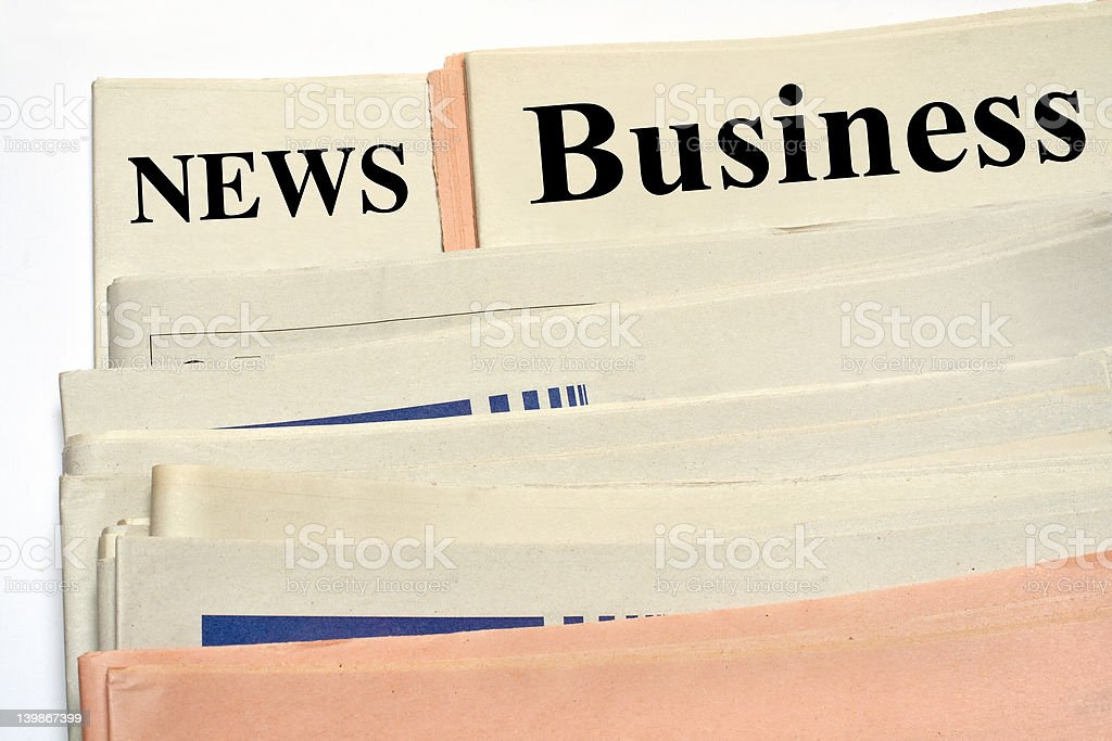 Stacked business newspapers on white background royalty-free stock photo
