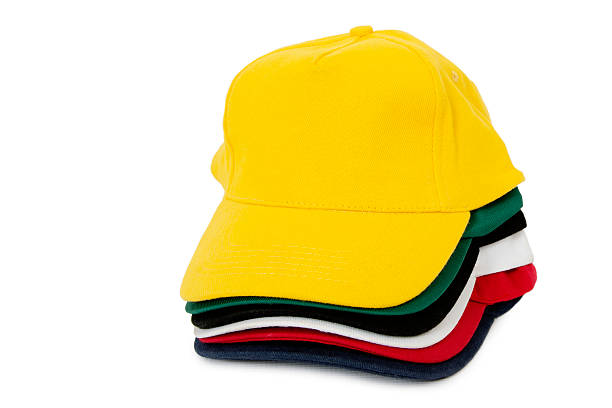 stacked caps - kelly green stock pictures, royalty-free photos & images