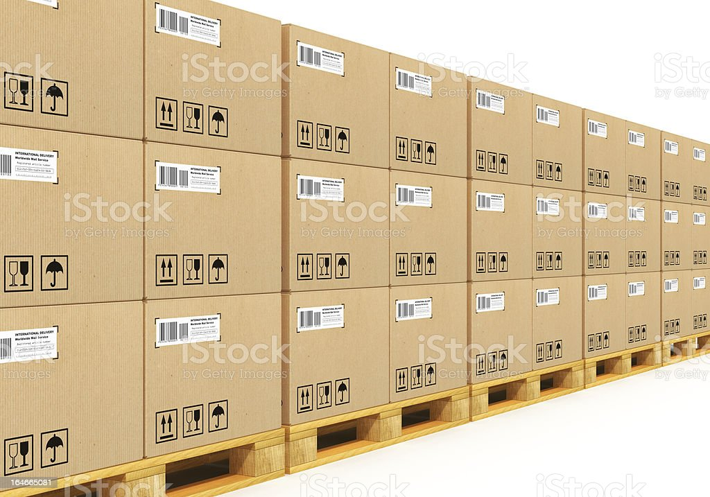 Stacked cardbaord boxes on shipping pallets royalty-free stock photo