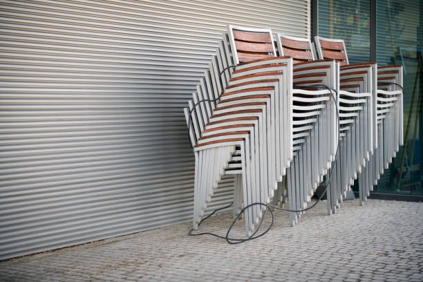 Stacked chairs of a closed sidewalk cafe stock photo