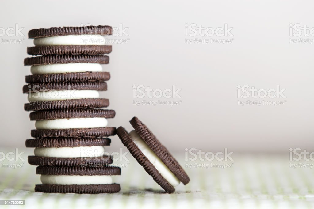 Stacked chocolate sandwich cookies against a white background