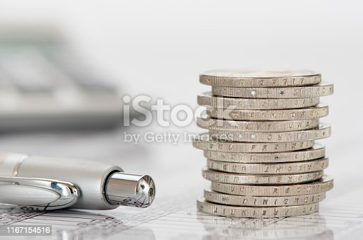 istock stacked coins of Euro currency on financial chart 1167154516