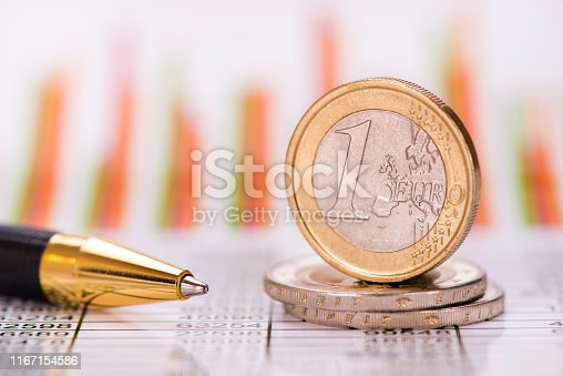 istock stacked coins of Euro currency on financial chart 1167154586