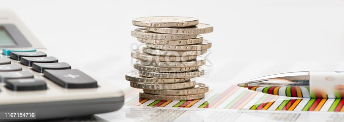 istock stacked coins of Euro currency on financial chart 1167154716