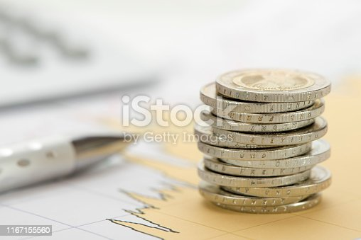 istock stacked coins of Euro currency on financial chart 1167155560