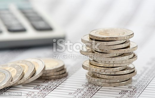 istock stacked coins of Euro currency on financial chart 1167155629